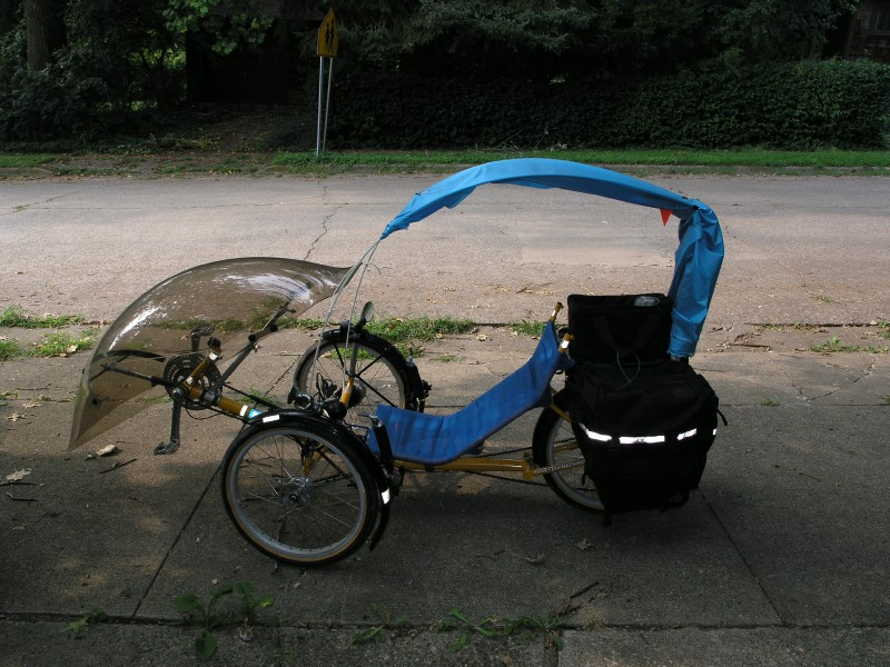 the trike canopy frame -- PVC flag poles (too lazy to even remove the flags) and fiberglass packing tape & Greenspeed Canopy Project