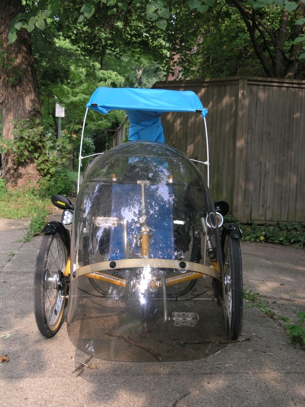 the trike with canopy (blue tablecloth material held on with paper cl&s) & Greenspeed Canopy Project